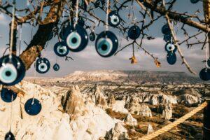 nazar amulets on tree branches near stony formations in cappadocia